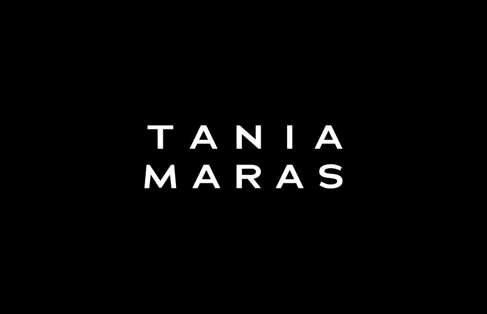 White Tania Maras logo on black background