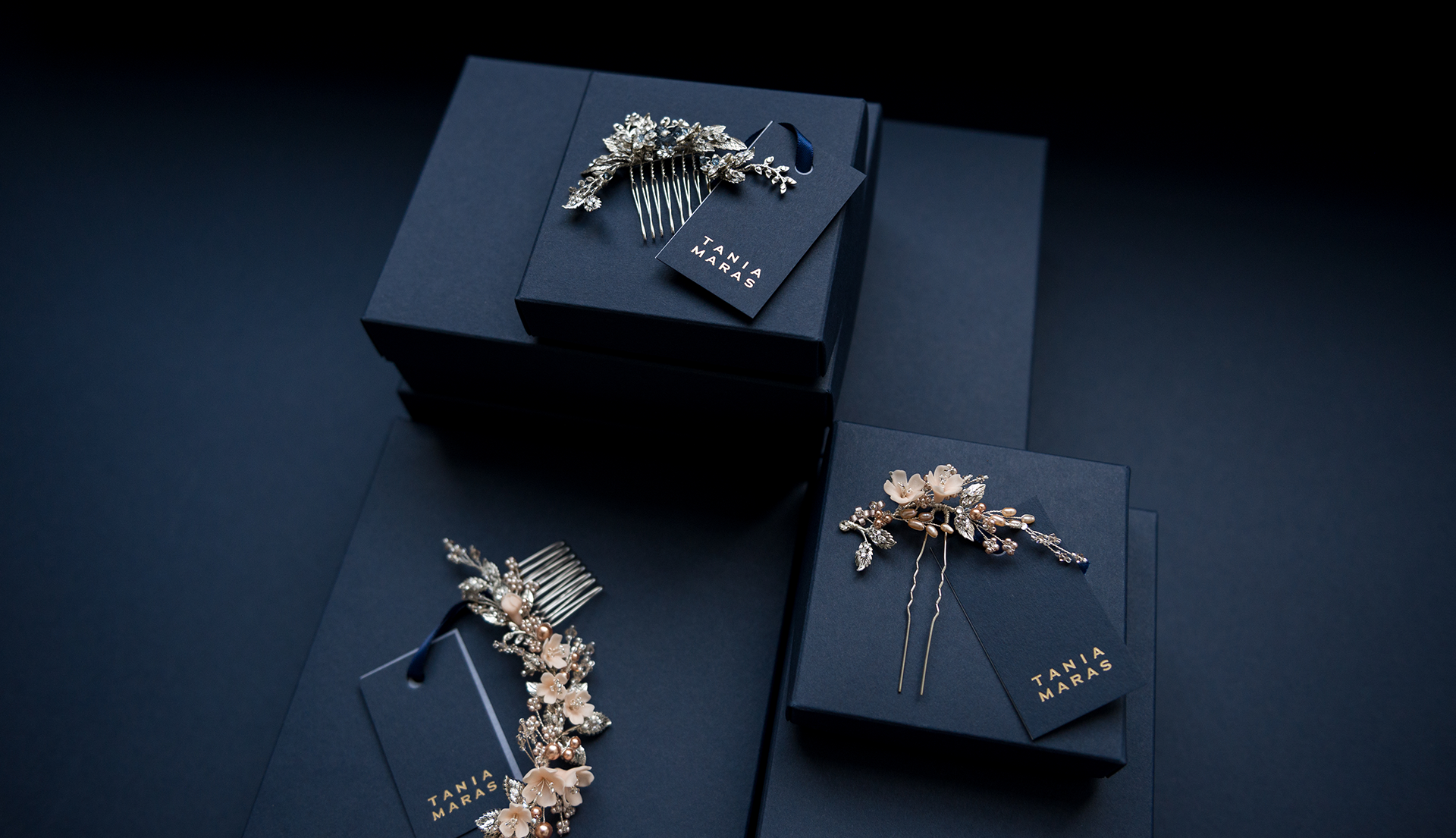 Bridal hair accessories with navy blue packaging and gold foils.